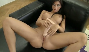 Ashley Brooke gives a closeup view be incumbent on her twat while masturbating