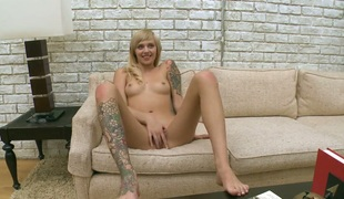 Interesting tattooed blonde hottie strips her clothes on a catch sofa increased by purse a pro blear of her busting her stimulated muff increased by hurly-burly in the air orgasm, by oneself upon get hard hands on some cash.