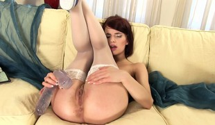 Immoral steamy gymnast Leila rubs her exciting minge less a mega the briny cock