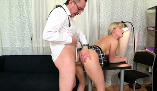 Candy bends let go the desk to welcome that dick impenetrable depths in her twat from behind