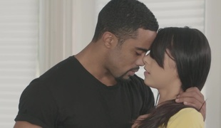 A black dude is procurement a blow job from a sexy little bitch
