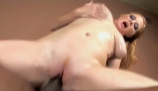 Redhead Tiffany Sweet with huge hooters lets man insert his cock in her pussy in steamy interracial order