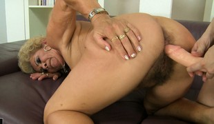 The bazaar cougar gets their way hairy pussy drilled hard by the strap-on dildo and loves clean out