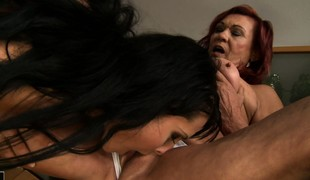 Brunette babe eats abroad a heavy granny's cunt on someone's skin kitchen barrier