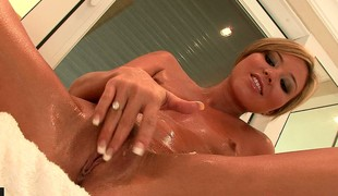 Sexy blonde hottie soaps up her sweet irritant and masturbates in go on a escort
