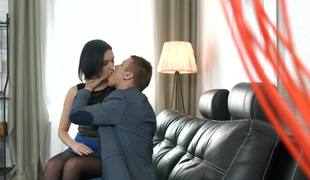 A brunette with a sexy ass is giving a blow job above a catch sofa