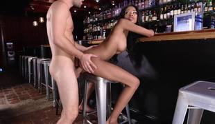 Black beauty on a ban stool takes white dick from behind