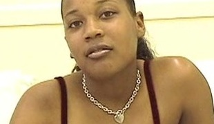 Ebony babe around big pair uses vibrator on her cunny