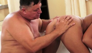 Unusual old fatso getting his asshole stimulated by a young blonde