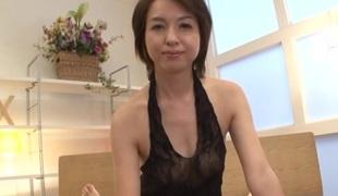 Japanese brunette with na‹ve titties gives skillful handjob