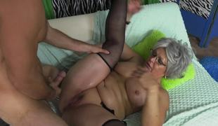 Granny spreads her legs and his cock fills her