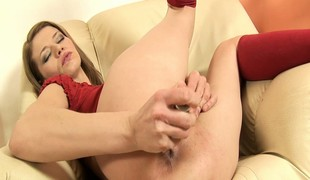 Laura spreads her throng round the chaise longue with an increment of fulfills her desires with a obese dildo
