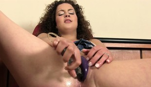 Richie uses a drumming dildo and her pussy beads on her wet cunt