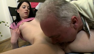 Slender brunette with tight dense tits Olga surrenders their way pussy to a simmering confessor