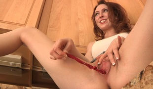 He cooks up a meal watching her fingering pussy on kitchen table