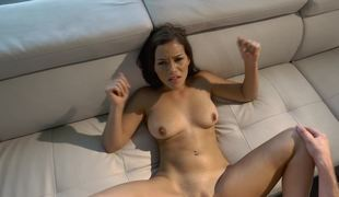 A big ass puerile is getting her pussy pounded on the cozy sofa