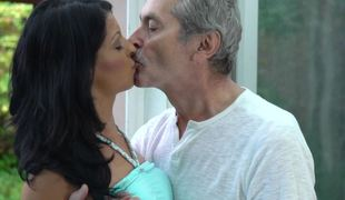 A skinny little slut with unpretentious tits is sucking an old dudes dick