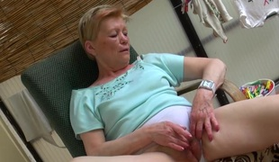 Old granny masturbating with sexy youngster with an increment of her dildo