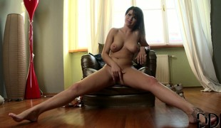 She teases her ass and her well executed tits, her fingers make her cum