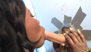 Ebony-skinned chick with big gut enjoying an interracial charge from around a in front of a mill cubicle